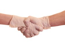 Handshake in the gloves. Handshake in the surgical gloves Stock Images