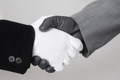 Handshake. With gloves, monochrome image Stock Photography