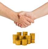Handshake and gold coins Stock Photography