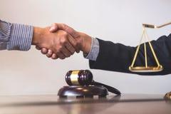 Handshake after good cooperation, Consultation between a male. Handshake after good cooperation, Consultation between a male lawyer and businessman customer Stock Photos