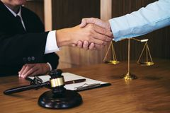 Handshake after good cooperation, Consultation between a male la. Wyer and businessman customer, tax and the company of real estate concept Royalty Free Stock Photography