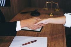 Handshake after good cooperation, Consultation between a male la. Wyer and businessman customer, tax and the company of real estate concept Royalty Free Stock Photos