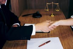 Handshake after good cooperation, Consultation between a male la. Wyer and businessman customer, tax and the company of real estate concept Royalty Free Stock Images