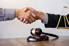 Handshake after good cooperation, Consultation between a male la. Wyer and businessman customer, tax and the company of real estate concept Royalty Free Stock Photo