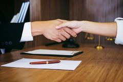 Handshake after good cooperation, Consultation between a male la. Wyer and businessman customer, tax and the company of real estate concept Royalty Free Stock Image