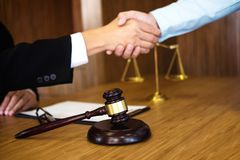Handshake after good cooperation, Consultation between a male la. Wyer and businessman customer, tax and the company of real estate concept Stock Photography