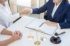 Handshake after good cooperation greeting, Having meeting with t. Eam at law firm, Consultation between a female lawyer and businesswoman customer, tax and the Stock Photography
