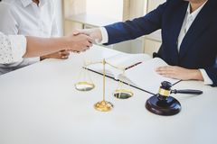 Handshake after good cooperation greeting, Having meeting with t. Eam at law firm, Consultation between a female lawyer and businessman customer, tax and the stock images