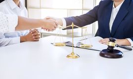 Handshake after good cooperation greeting, Having meeting with t. Eam at law firm, Consultation between a female lawyer and businessman customer, tax and the stock photography