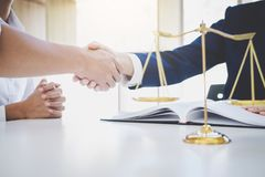 Handshake after good cooperation greeting, Having meeting with t. Eam at law firm, Consultation between a female lawyer and businessman customer, tax and the royalty free stock photo