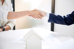 Handshake after good cooperation, Real estate broker residential. Agent shaking hands with customer after good deal agreement house rent listing contract Royalty Free Stock Image