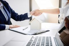 Handshake after good cooperation, Real estate broker residential. Agent shaking hands with customer after good deal agreement house rent listing contract Royalty Free Stock Photography
