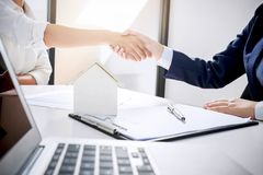 Handshake after good cooperation, Real estate broker residential stock photography