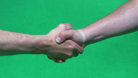 Handshake on green background stock footage