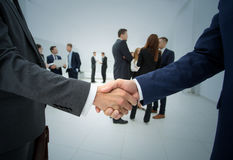 Handshake. Group of business people. Teamwork. Business handshake. Business handshake and business people concept. Two men shaking hands over sunny office Royalty Free Stock Photos