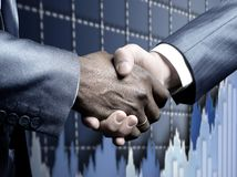 Handshake - Hand holding royalty free stock photo
