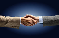 Handshake - Hand holding on black stock image
