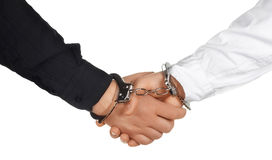 Handshake with handcuffs Stock Photo