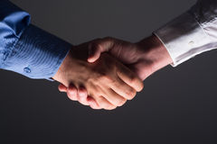 Handshake Handshaking in dark with low light Stock Image