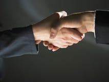 Handshake Handshaking on light and dark Stock Images