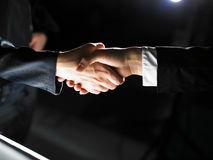 Handshake Handshaking on light and dark Royalty Free Stock Image