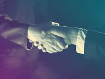 Handshake Handshaking and light Royalty Free Stock Images