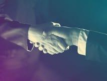 Handshake Handshaking and light Royalty Free Stock Images
