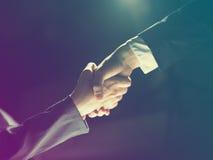 Handshake Handshaking on light and dark Stock Image