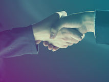 Handshake Handshaking on light and dark Stock Photo