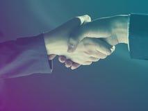 Handshake Handshaking on light and dark Stock Photo
