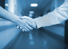 Handshake in the hospital corridor Royalty Free Stock Images