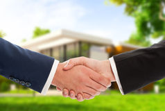 Handshake on house outdoor background Stock Photography