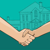 Handshake with house. Two men shaking hands on the background of the house - sale or rental concept Stock Image