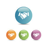 Handshake icon on colored buttons. And white background Royalty Free Stock Photo