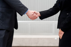 Handshake isolated on business background Stock Photo
