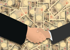Handshake on Japanese Yen Stock Photo