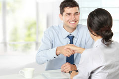 Handshake after a job recruitment interview. Handshake to seal a deal after a job recruitment meeting Stock Photography