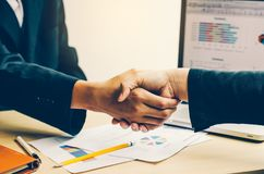 Handshake between joint venture businessmen. After good management and have good concept Royalty Free Stock Image