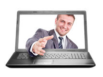 Handshake from laptop Stock Photo