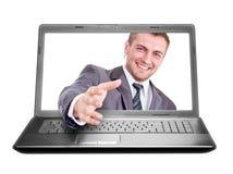 Handshake from laptop Stock Photo