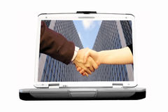 Handshake in laptop Royalty Free Stock Photos