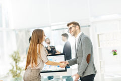 Handshake between lawyer and client after reviewing the investment plan for development of the company. Royalty Free Stock Images