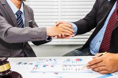 Handshake between a lawyer and a male office worker royalty free stock photography