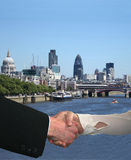 Handshake with London skyline Stock Photo