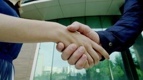 Handshake of man and woman stock video