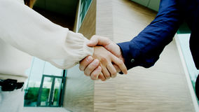Handshake of man and woman Royalty Free Stock Images