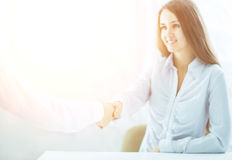 Handshake Manager and client on a background of bright office Stock Photography