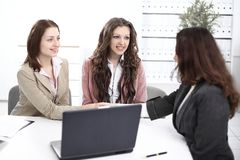 Handshake Manager and the client in the office stock photography