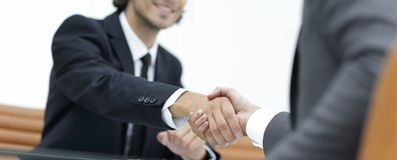Handshake Manager and the client sitting in the office Royalty Free Stock Photos