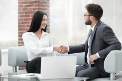 Handshake of manager and client sitting in the office lobby. Royalty Free Stock Images